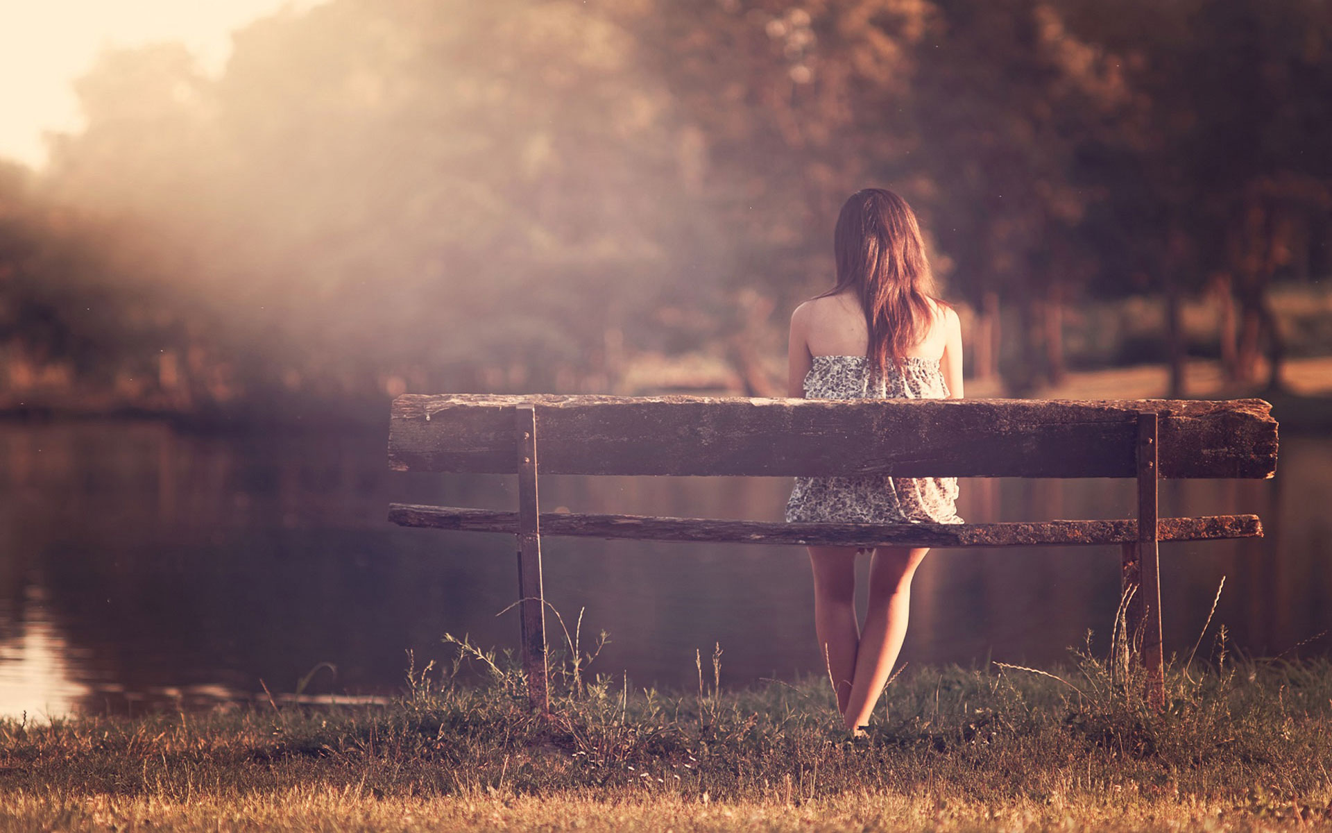sad-lonely-girl-sitting-on-bench-in-a-park